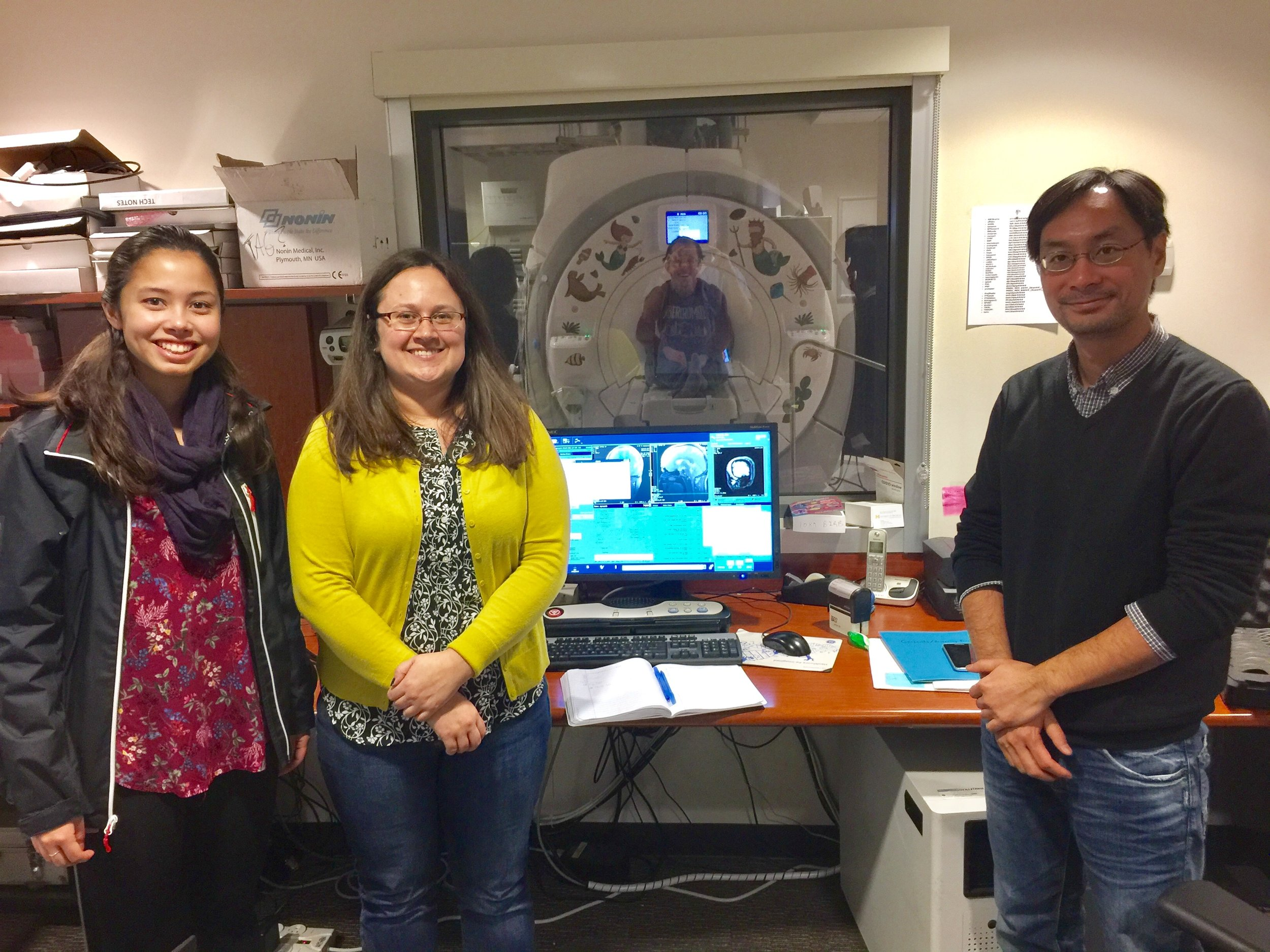 UM lab members Cece, Emily, Andrew, and Ho Ming piloting a new fMRI study. December 2016