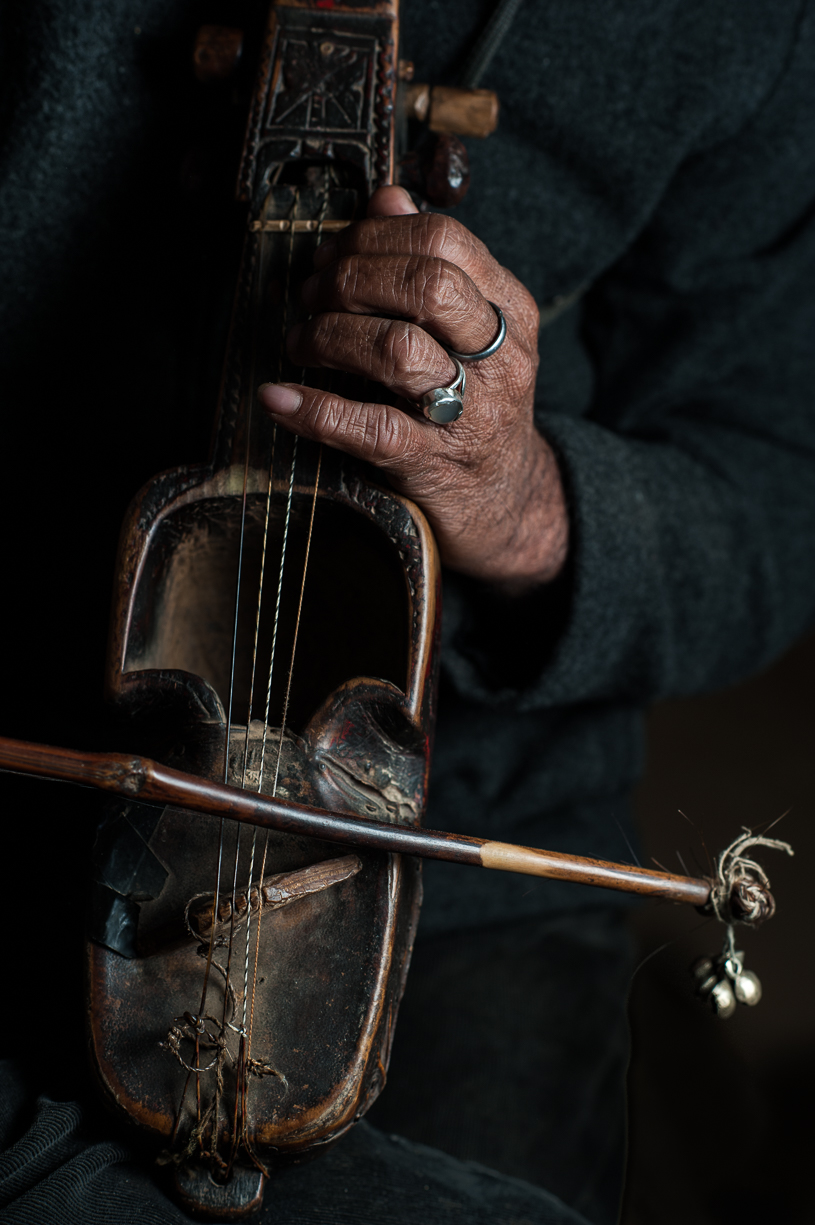 The sarangi is the four-stringed instrument played by the Gandharba people.