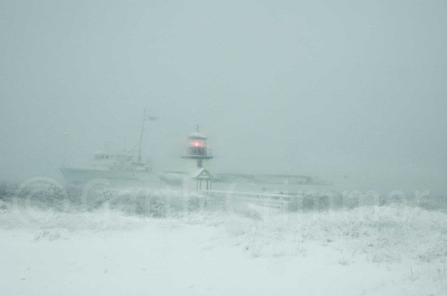 Supply boat in snow storm
