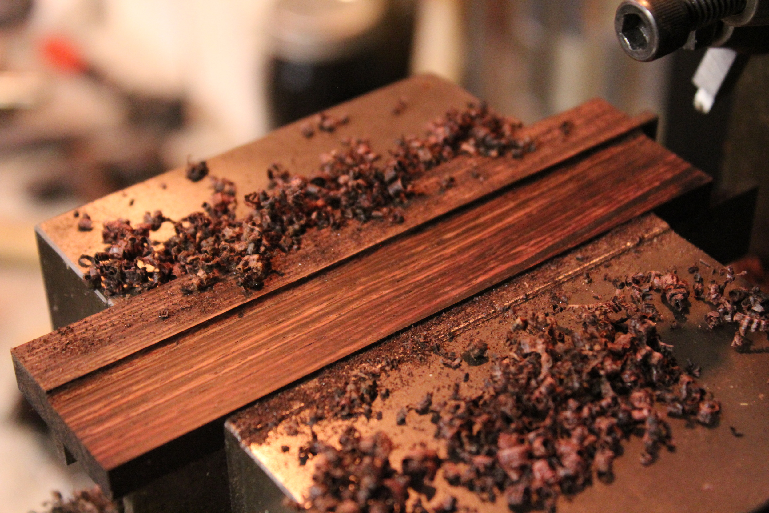 Shaper milling down Rosewood. Not typically used for wood, shapers do accurate work and leave a beautiful finish.