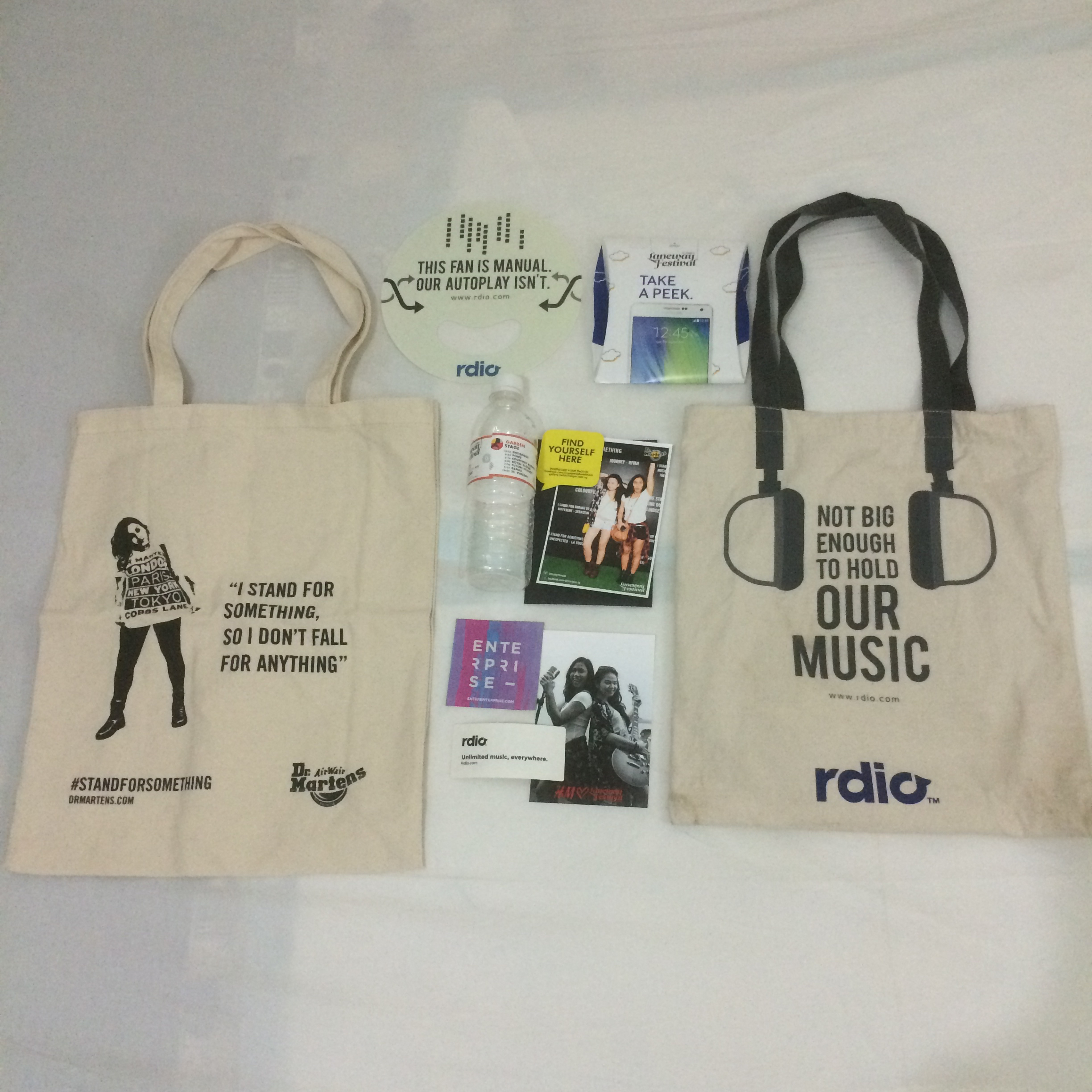 Dr. Martens tote bag, Rdio fan, Samsung rain poncho, free water, photos from Dr. Martens and H&M booth, stickers and Rdio tote bag.