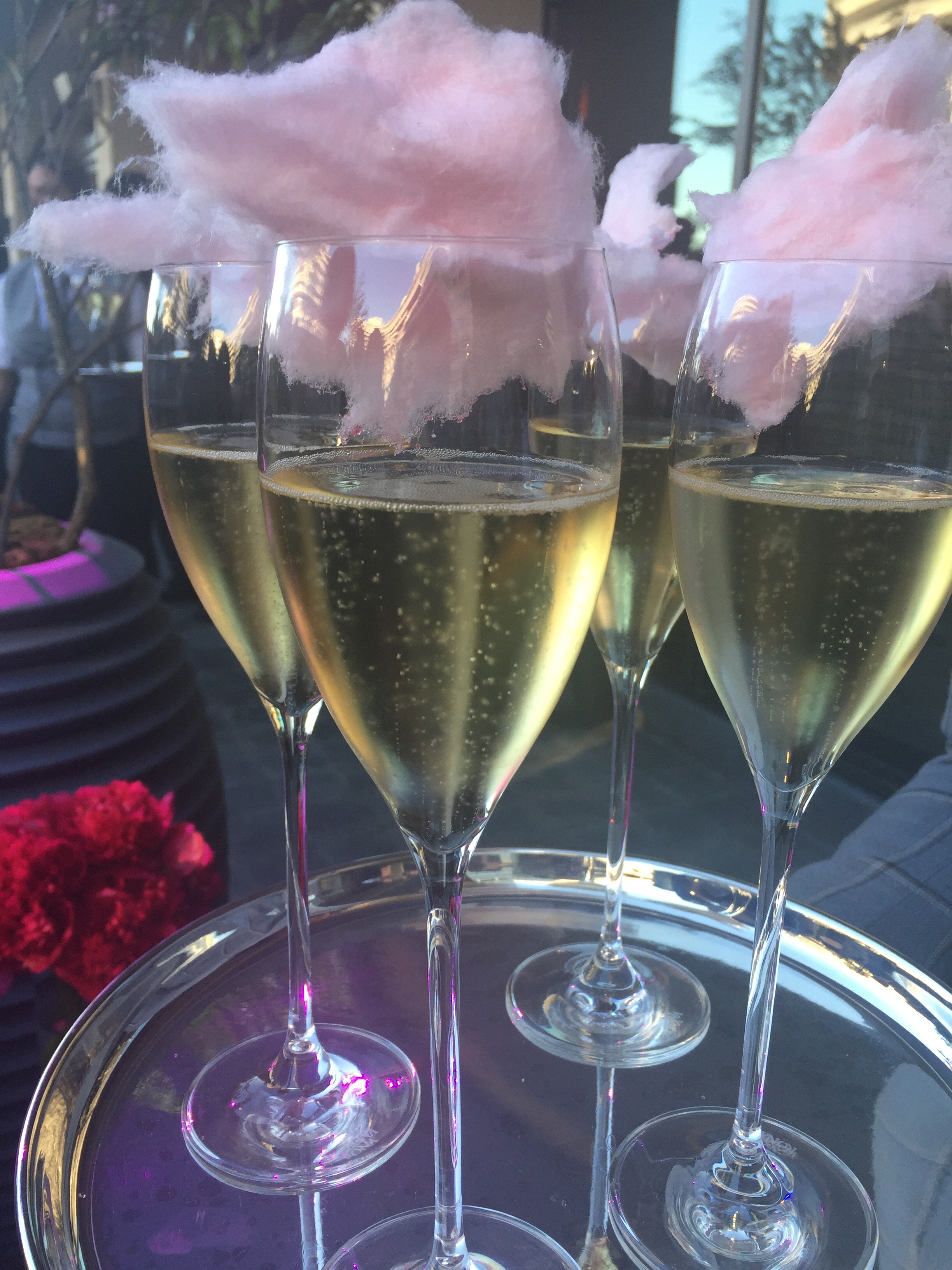 Champagne with cotton candy. Adorable party trick.
