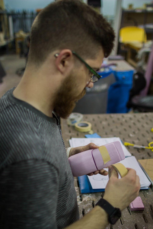 Designer Colin Beney Refining sketch models.
