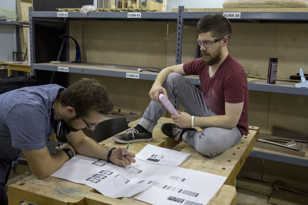 Designers Beney & Brownhill Discussing Interface Flow and Product Form.