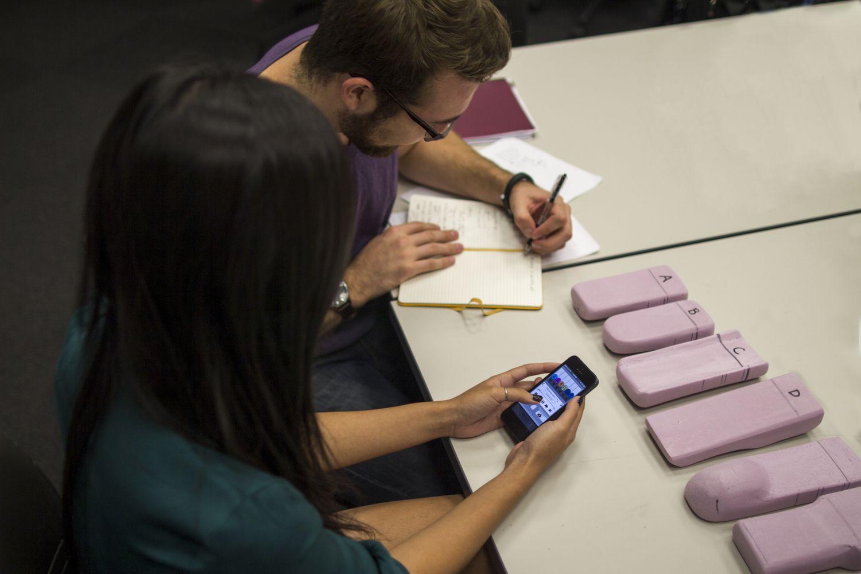Designer Ryan Brownhill receiving user feedback on interactive wireframes.