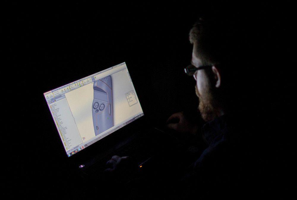 Designer Colin Beney creating a final 3-D model in Solidworks.