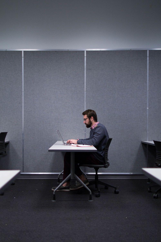 Designer Ryan Brownhill adding the final visual design to wireframes.