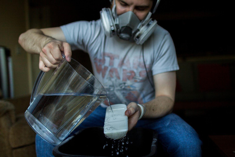 Designer Colin Beney wet sanding the 3-D printed prototype.