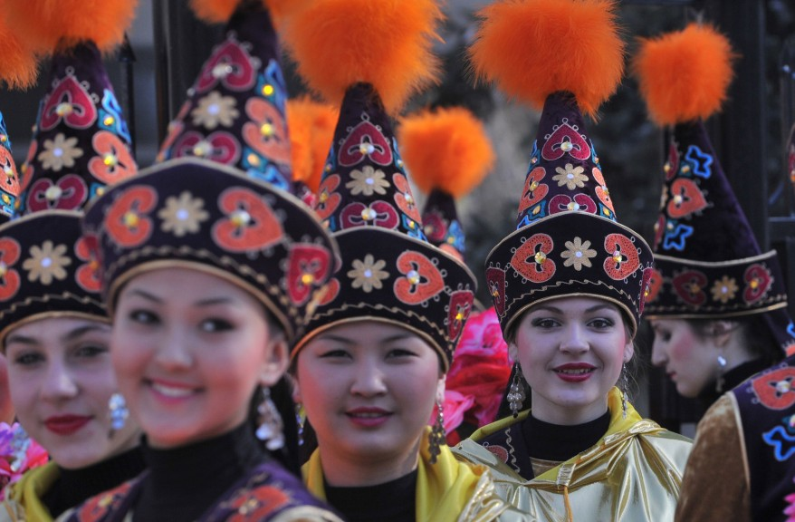 Women of Kyrgyzstan of different ethnicities in traditional Kyrgyz dresses and hats