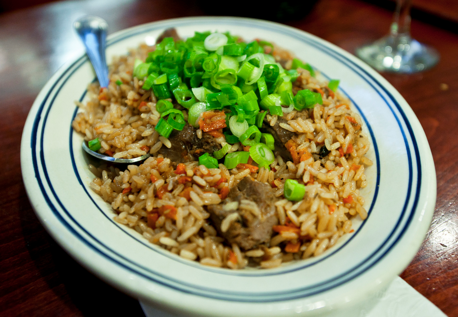 Plov - is a rice dish where meat is cooked separately first and then everything is cooked in one closed wok with water in the bottom.
