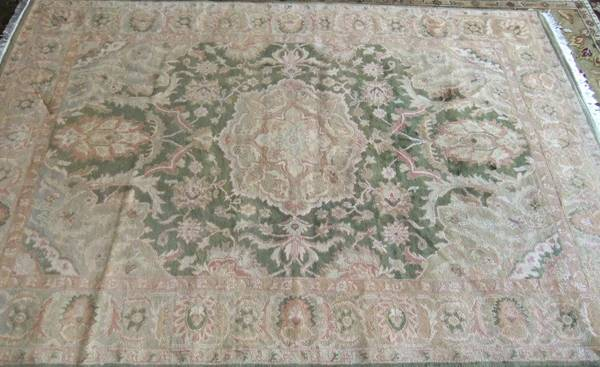6' x 9' Wool Rug $100  - Would look great if you were going for the more muted tone look in your room.