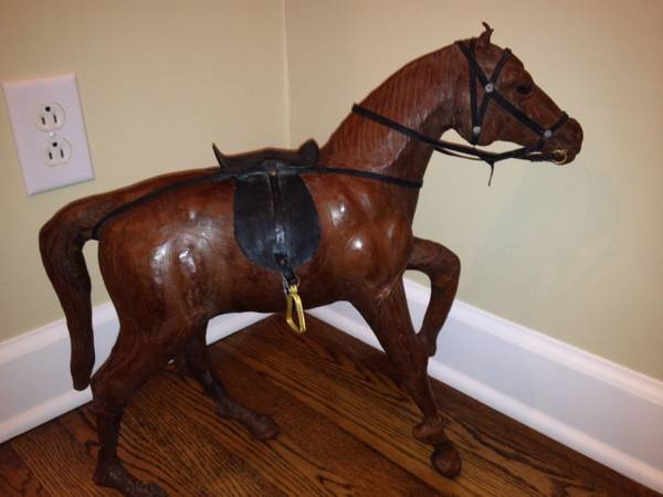 Antique Leather Horses Set of 3 $100  - I thought these were pretty unique and could be a cool decorative accessory.