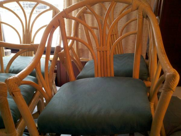 Rattan Chairs (set of 4) $80  - These chairs would look great in a sunroom or screened in porch or in a breakfast nook, with a coat of spray paint and new cushions they would be totally transformed.