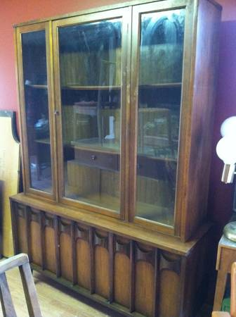 Mid Century Modern China Cabinet $500  - This cabinet is 2 pieces, the hutch and the buffet. Its a big piece and could really make a statement in your dining room. I love the design of the buffet.