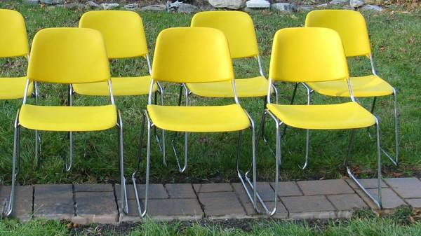 Vintage Stacking Chairs $80 for 6  - Seller has a total of 32 chairs some are blue and some are yellow, price varies based on how many you want. I think these would be cool office chairs or could be fun for a more modern kitchen table.