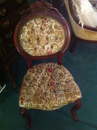 Antique Victorian Chair $100  - I posted a sofa similar to this a few weeks ago. A great way to modernize this chair would be to paint the wood portion.
