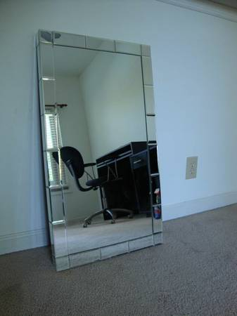 West Elm Mirror $38  - Seller has listed that the mirror has a tiny chip on the corner. Retails for $149 at West Elm.