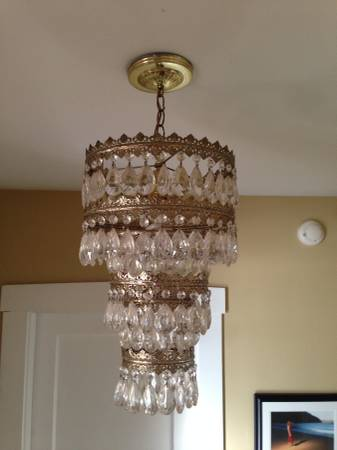 Four Tiered Chandelier $80  - This chandelier has a great vintage glam feel - could also be cool if the gold portions were spray painted.