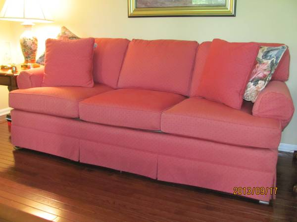 Raspberry Colored Sofa $350  - This could be really pretty with some new decorative pillows. Check out  this post on Apartment Therapy  with some great photos of rooms with pink sofas.