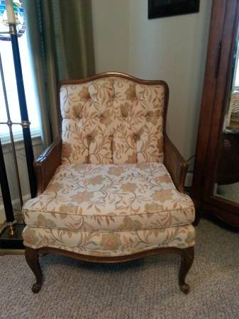 French Style Antique Chair     $125   This chair could be easily modernized by painting the wood portions.    View on Craigslist