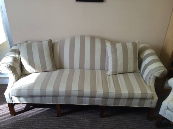 Striped Sofa and Chairs     $200   This sofa is being sold with 2 wingback chairs. I think this sofa could be really pretty in a living or family room and stripes are a pattern that will never go out of style. I'd remove the pillows on it and replace with new ones all in the more neutral color palette. You could also paint the wood legs the gray/khaki color of the darker stripe and it would modernize it.    See My Idea      View on Craigslist