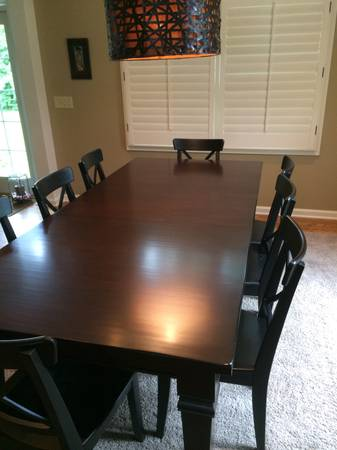 Pottery Barn Dining Table     $500   This table retailed for $1700 and has 2 leaves (photographed with one in) - seats 10 with both leaves in. Chairs in the photograph are from IKEA and are $10 each with the table.    View on Craigslist