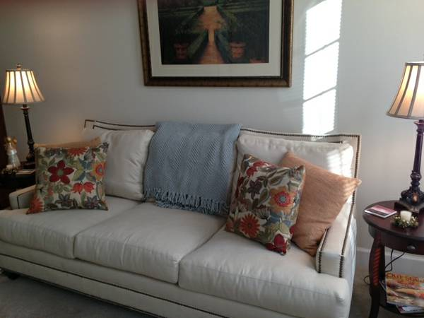 White Sofa with Nailhead Detailing     $375     View on Craigslist