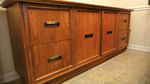 Oak Credenza     $130   I don't love this as is but think a coat of paint would totally transform it - would be great in an office or as a entertainment center.    View on Craigslist