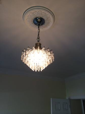 Crystal/Glass Chandelier     $75   I think this would be pretty hanging in a master bath.    View on Craigslist