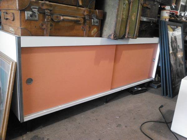 Mid Century Credenza     $175   I love the colors of this piece. Would be a great TV stand, buffet, or office storage.    View on Craigslist