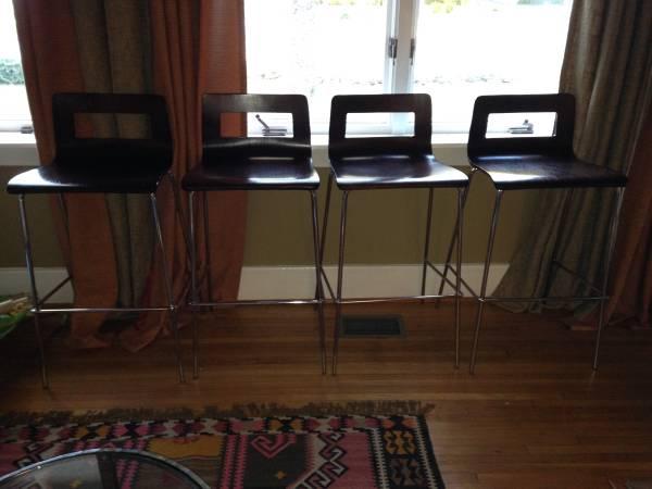 Set of 4 CB2 Bar Stools     $160     View on Craigslist