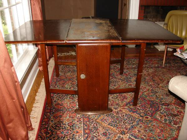 Antique Drop Leaf Table     $110   This is a really versatile piece and just needs to be refinished.    View on Craigslist