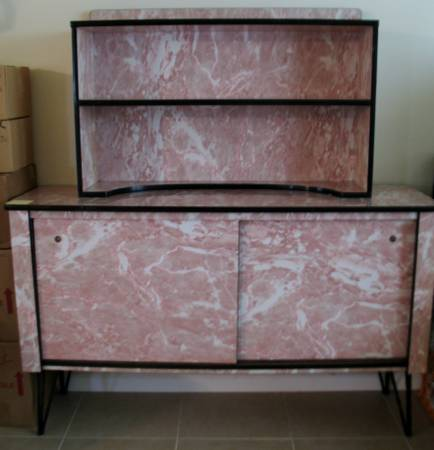 Retro Pink Buffet with Hutch     $500   I realize this piece is not for everyone but it could be a fun statement piece in mid century or modern room. I personally like the way it looks without the hutch on top - would be really pretty styled with some white and gold pieces. Looks like the seller also has another buffet for sale too.    View on Craigslist