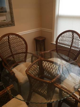 Wicker Dinette Set     $100   I think this set would look great painted and with new cushions.    View on Craigslist