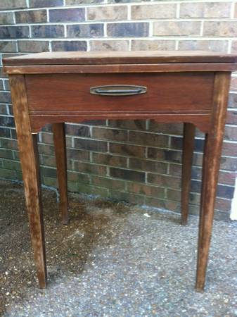 Vintage Sewing Cabinet     $35   This piecejust needs a coat of paint and would make a great side table.    View on Craigslist