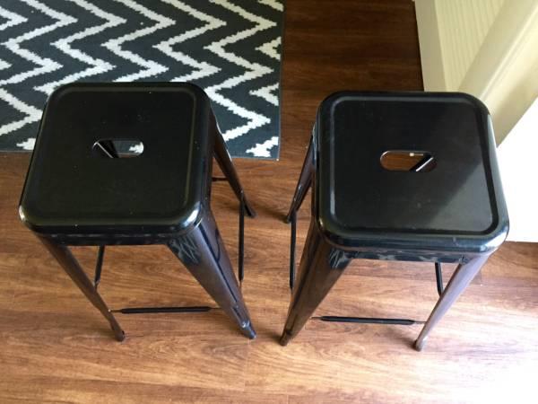 Pair of Black Metal Barstools     $50     View on Craigslist