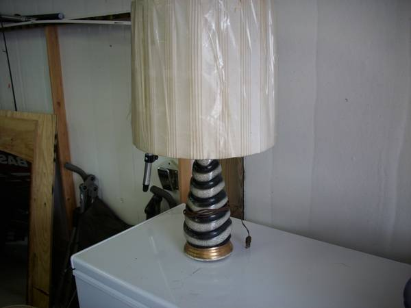Pair of Vintage Lamps     $50   I love these lamps - you can't go wrong with black and white and gold.All they need is new shades and they will be fabulous.    View on Craigslist