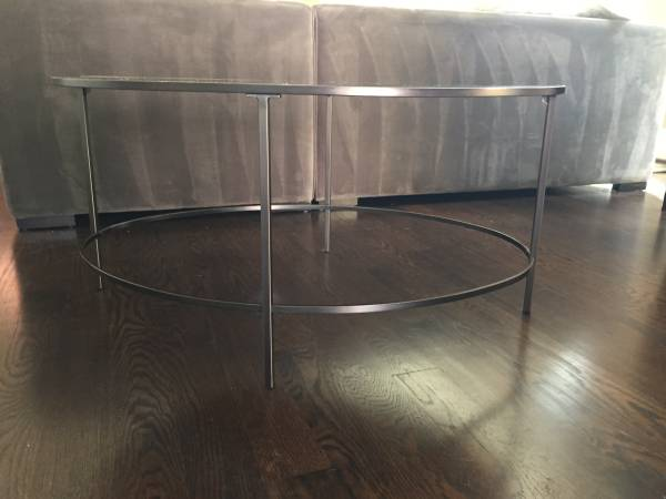 West Elm Coffee Table     $150   This coffee table has a mirrored top    View on Craigslist