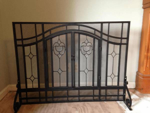 Iron and Glass Fireplace Screen     $125   This was over $400 new.    View on Craigslist
