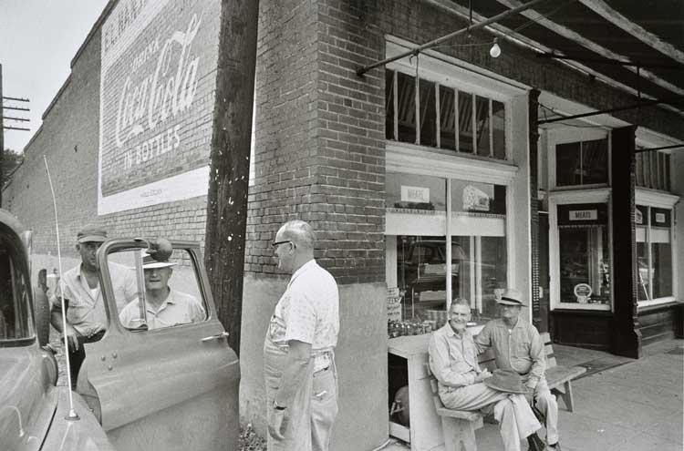 Untitled (Man at store corner), 1960-1972 Gelatin Silver Print 16 x 20inches