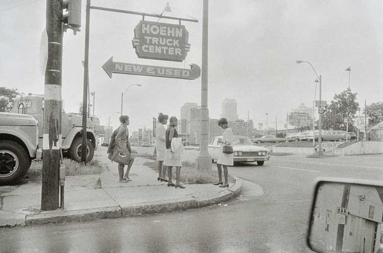Untitled (Woman on street, Hoehn Truck sign), 1960-1972 Gelatin Silver Print 16 x 20inches