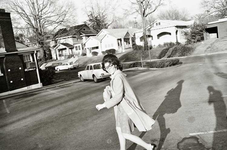Untitled (Woman crossing street), 1960-1972 Gelatin Silver Print 16 x 20inches