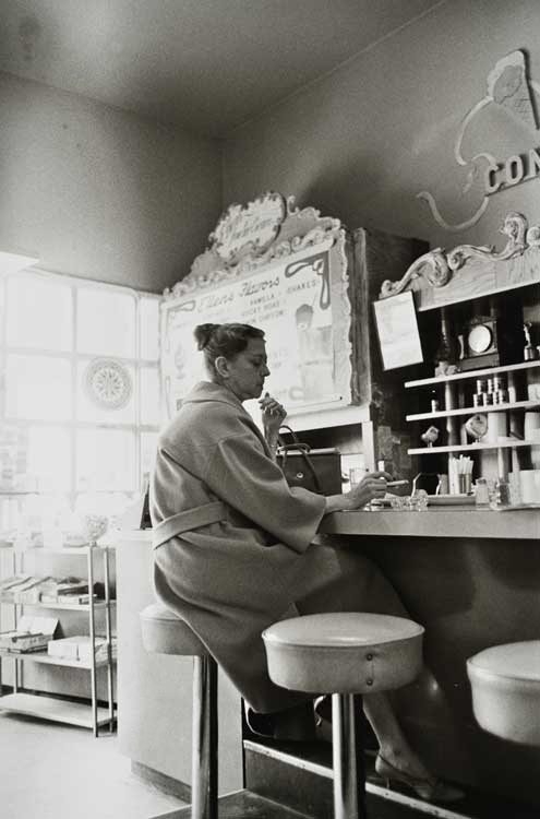 Untitled (Woman at counter), 1960-1972 Gelatin Silver Print 20 x 16 inches