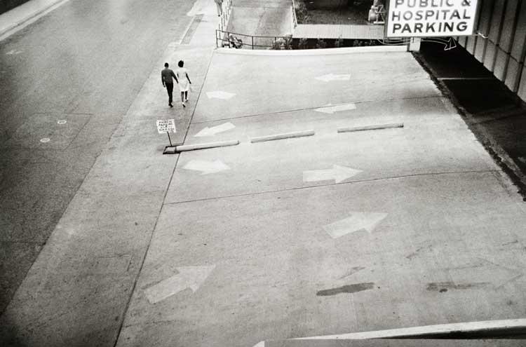 Untitled (Pedestrians, parking lot), 1960-1972 Gelatin Silver Print 16 x 20inches