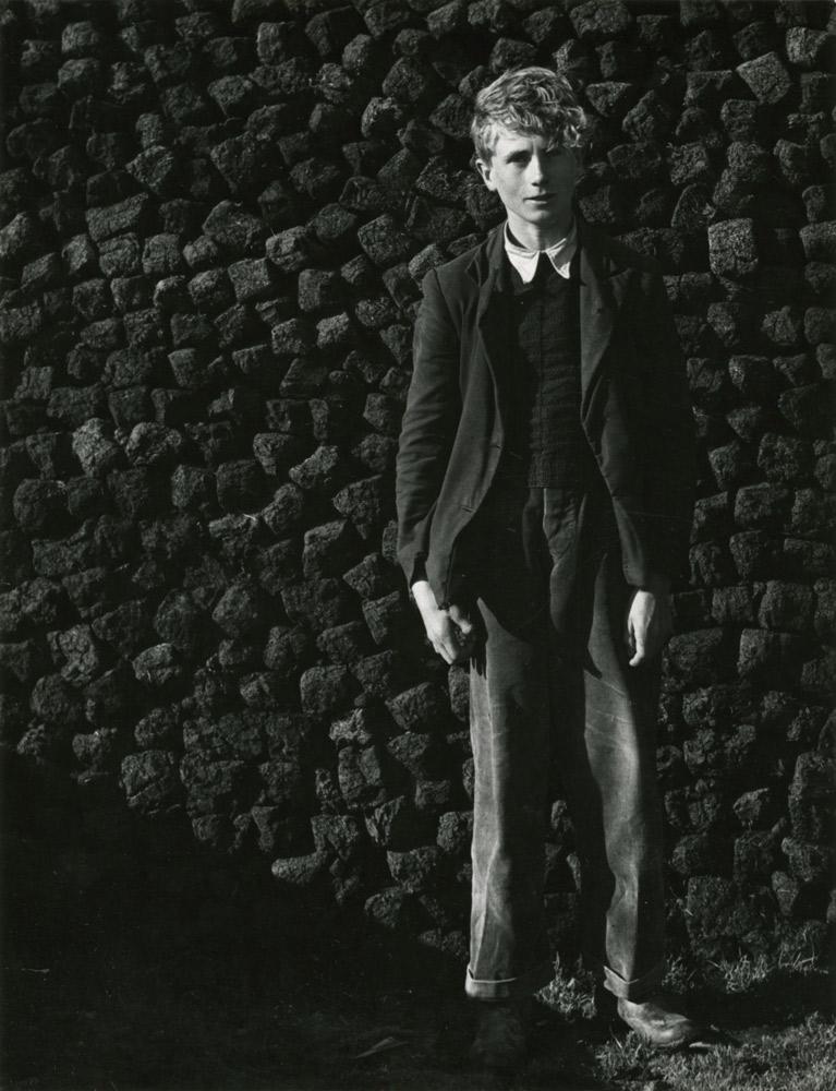 Irish Boy Against a Peat Wall ,  Ireland,  1954