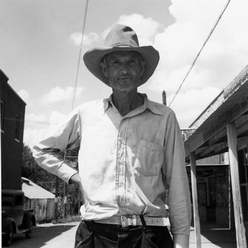 Man in Hat in Street, Oklahoma, 1938
