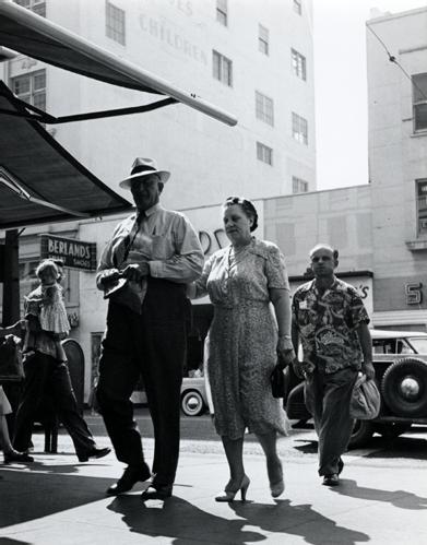 Couple Crossing Street [Berland's], Oakland, 1952