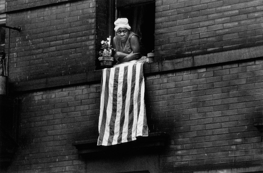 Bruce Davidson ,  Untitled , (Flag in window), from  Time of Change , 1961-65