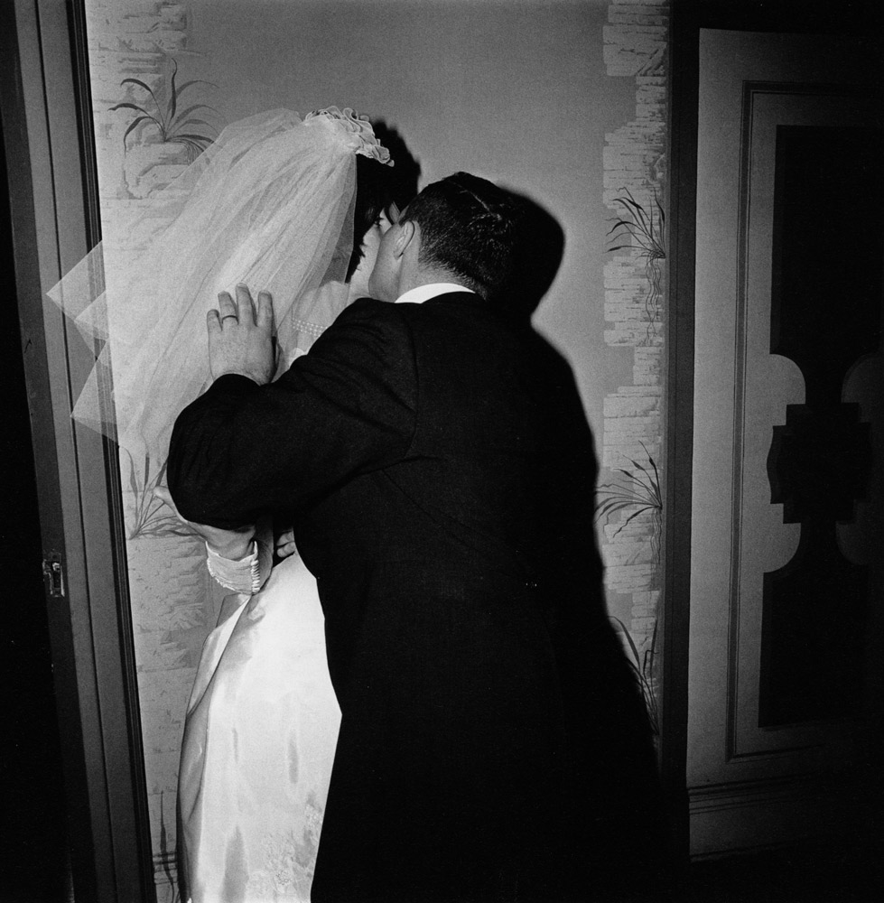 Diane Arbus ,  Groom Kissing his Bride, NYC , 1966
