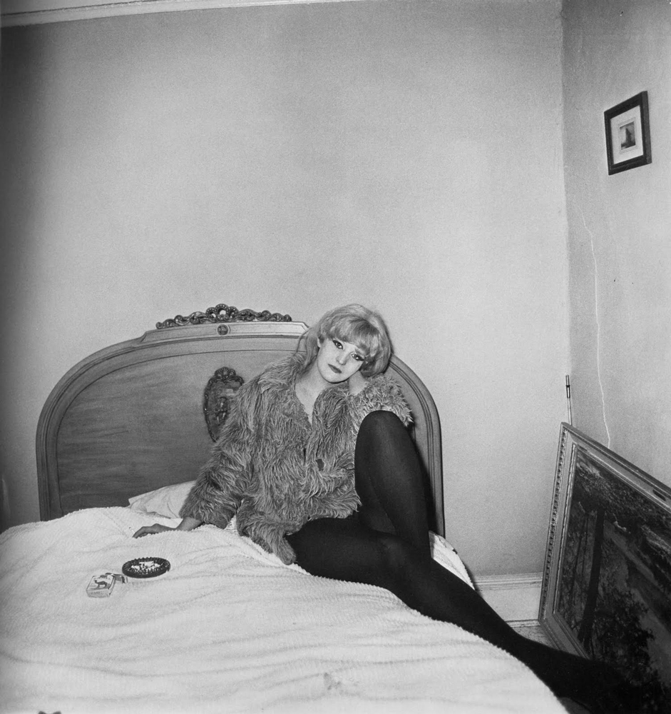 Diane Arbus ,  Girl in a Coat lying on Her Bed, NYC , 1968